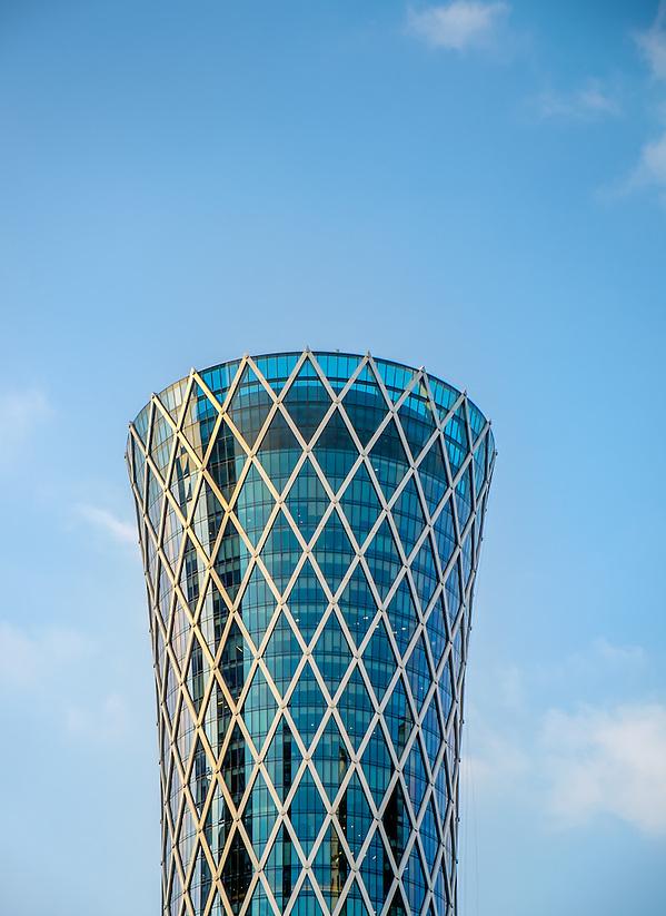 DOHA, QATAR - CIRCA DECEMBER 2013: Architectural detail of the Tornado Tower Doha, one of the tallest skyscrapers in the famous West Bay in Al Corniche. (Daniel Korzeniewski)