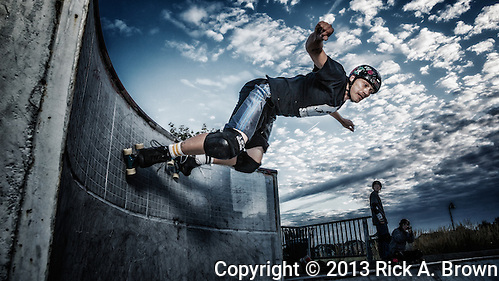 USA, Oregon, Eugene, skater doing a stunt in a skate park. MR (Rick A. Brown)