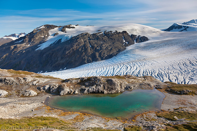 Mountain pond and the Exit glacier and Harding Ice Field, Kenai Fjords National Park,  Kenai Peninsula, southcentral, Alaska. (Patrick J. Endres / AlaskaPhotoGraphics.com)