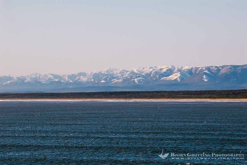 Russia, Sakhalin, Sea of Okhotsk. Sakhalin coastline with snow covered mountains. (Photo Bjorn Grotting)
