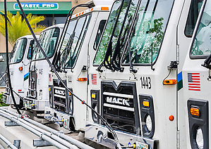 "CNG-powered (compressed natural gas) Mack trucks line up at Waste Pro's time-fill station, March 19, 2016, in Jacksonville, Florida. Waste Pro offers waste and recycling services to more than two million residential customers and more than 40,000 businesses in Alabama, Florida, Georgia, South and North Carolina, Louisiana, Mississippi, and Tennessee. The company has committed to ""going green"" by implementing a number of green initiatives, including using CNG (compressed natural gas) in its trucks, recycling more waste instead of sending it to landfills, and powering its regional headquarters throuh solar energy. (Photo by Carmen K. Sisson/Cloudybright) (Carmen K. Sisson/Cloudybright)"