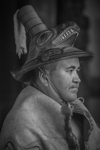 Chuck Miller wears his 300 year olf moosesh=kin robe and coho hat that has been passed down to him from uncle to nephew.   Totem National Historic Park in Sitka Alaska. (Clark James Mishler)