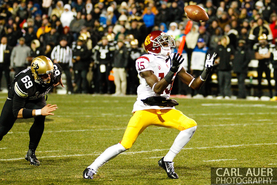November 23rd, 2013:  USC Trojans sophomore wide receiver Nelson Agholor (15) juggles the ball after calling for a fair catch on a Colorado punt in second quarter action of the NCAA Football game between the University of Southern California Trojans and the University of Colorado Buffaloes at Folsom Field in Boulder, Colorado (Carl Auer/ZUMAPRESS.com)