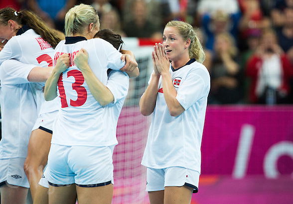 11 AUG 2012 - LONDON, GBR - Gøril Snorroeggen (NOR) (right) of Norway celebrates winning the women's London 2012 Olympic Games handball final against Montenegro at the Basketball Arena in the Olympic Park, in Stratford, London, Great Britain .(PHOTO (C) 2012 NIGEL FARROW) (NIGEL FARROW/(C) 2012 NIGEL FARROW)