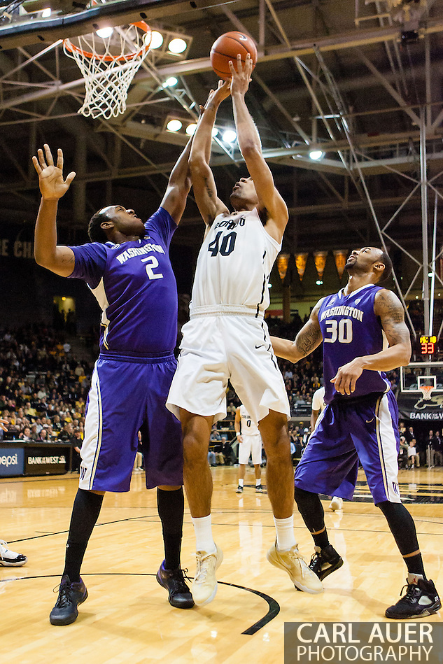 February 9th, 2014:  Colorado Buffaloes sophomore forward Josh Scott (40) shoots over Washington Huskies senior forward Perris Blackwell (2) in the first half of the NCAA Basketball game between the Washington Huskies and the University of Colorado Buffaloes at the Coors Events Center in Boulder, Colorado (Carl Auer/ZUMAPRESS.com)