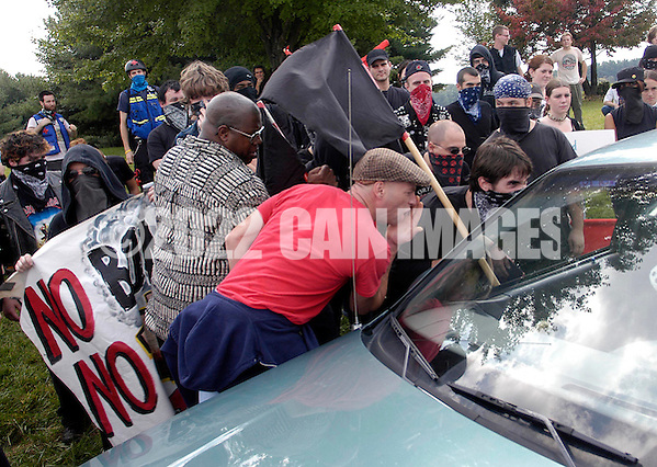 VALLEY FORGE, PA - SEPTEMBER 25: Anti-Nazi protesters shout into a car outside an American Nazi rally at Valley Forge National Par September 25, 2004 in Valley Forge, Pennsylvania. Hundreds of American Nazis from around the country were expected to attend. (Photo by William Thomas Cain/Getty Images) (William Thomas Cain/Getty Images)