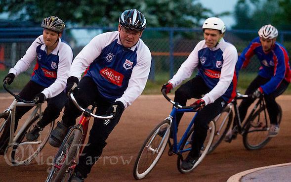 26 MAY 2015 - IPSWICH, GBR - Phil Clarke (second from the left) leads Mark Debman (left) and Darren Mitchell (second from the right) and Ian Johnson (right) during an Ipswich Cycle Speedway Club championship night at Whitton Sports and Community Centre in Ipswich, Suffolk, Great Britain (PHOTO COPYRIGHT © 2015 NIGEL FARROW, ALL RIGHTS RESERVED) (NIGEL FARROW/COPYRIGHT © 2015 NIGEL FARROW : www.nigelfarrow.com)