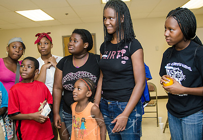 "Students listen as Young People's Project program coordinator Marquise Lowe (not pictured) gives directions for an ""icebreaker"" activity Aug. 3, 2013, in Jackson, Miss. YPP was founded in 1996 and focuses on math literacy as a way to empower youth and help them overcome obstacles to their success. (Photo by Carmen K. Sisson/Cloudybright) (Carmen K. Sisson/Cloudybright)"
