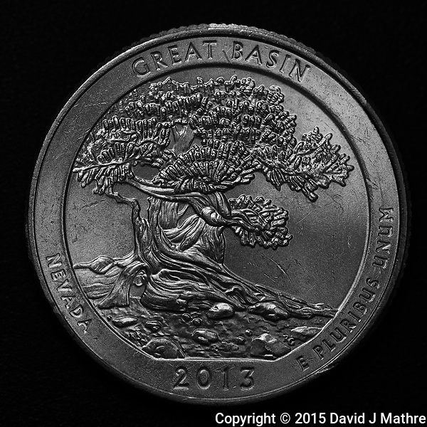 Great Basin National Park -- Back Side of a 2013 United States Quarter. This is one of my favorite National Parks, and probably one of the least visited. Some of the Bristlecone Pines in the park are nearly 5000 years old. Image taken with a Fuji X-T1 camera and 60 mm f/2.4 macro lens (ISO 200, 60 mm, f/2.8, 1/60 sec, flash). Raw image processed with Capture One Pro 8, Focus Magic, and Photoshop CC. (David J Mathre)