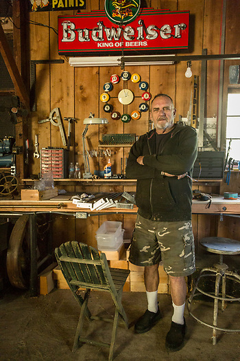 My neighbor and vineyard owner, Jack Smith, pauses between projects in his barn workshop on School Street in Calistoga (Clark James Mishler)