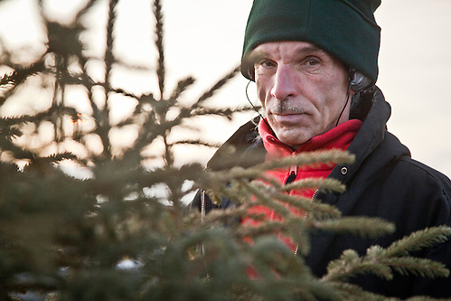 Rick sells Christmas trees at the corner of Northern Lights and Eagle Street, Anchorage (Clark James Mishler)