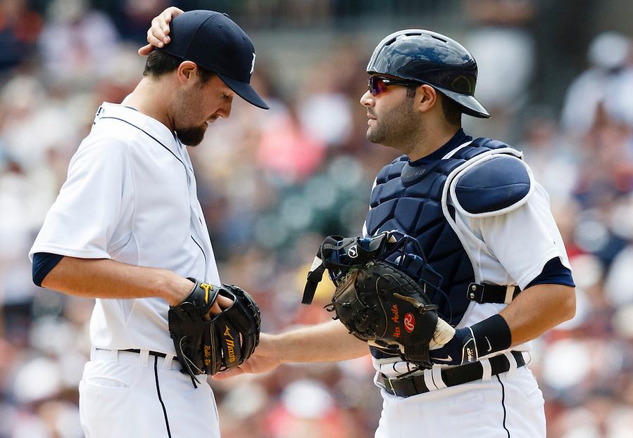 May 22, 2014; Detroit, MI, USA; Detroit Tigers catcher Alex Avila (13) talks to starting pitcher Robbie Ray (38) during the game against the Texas Rangers at Comerica Park. Mandatory Credit: Rick Osentoski-USA TODAY Sports (Rick Osentoski/Rick Osentoski-USA TODAY Sports)