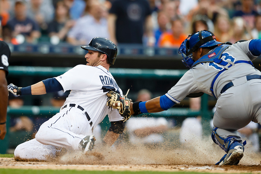 May 8, 2015; Detroit, MI, USA; Detroit Tigers third baseman Andrew Romine (27) slides in safe at home on Kansas City Royals catcher Salvador Perez (13) in the second inning at Comerica Park. Mandatory Credit: Rick Osentoski-USA TODAY Sports (Rick Osentoski/Rick Osentoski-USA TODAY Sports)