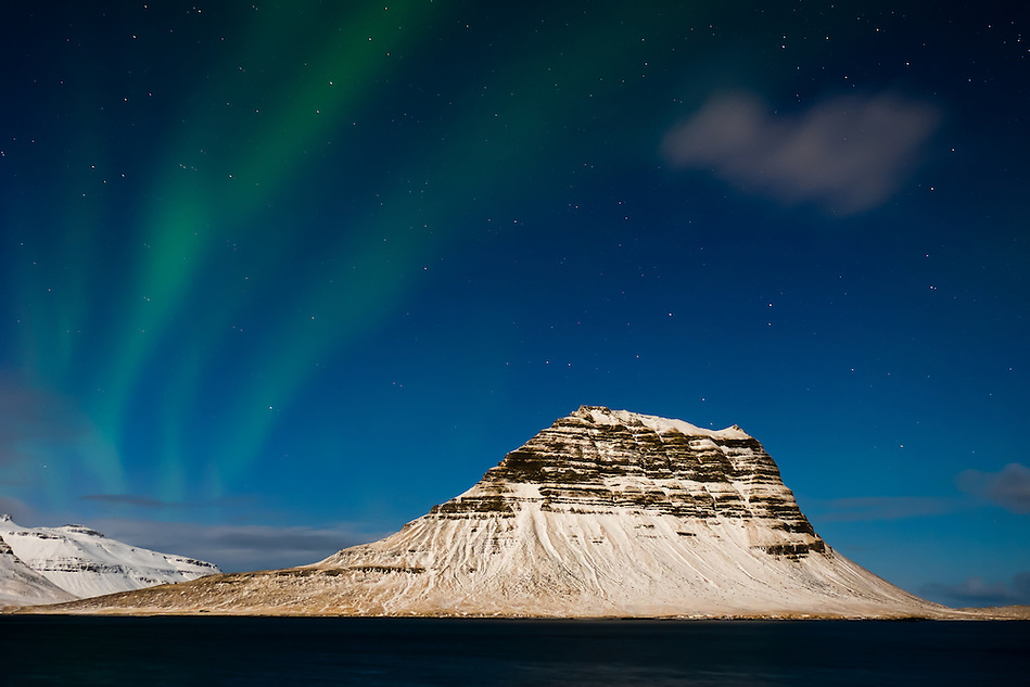 GRUNDARFJOROUR, ICELAND - CIRCA MARCH 2015: Aurora Borealis, also known as Northern Lights over the Kirkjufell mountain near Grundarfjordur, a landmark in the Snaefellsness Peninsula. (Daniel Korzeniewski)