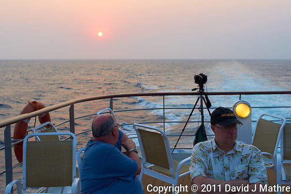 Jon and Rob waiting for sunset on Deck 6 of the M/V Explorer. UTW-II 2011 Spring Enrichment Voyage. Image taken with a Leica X1 (ISO 100, 24 mm, f/4.5, 1/160 sec). (David J Mathre)