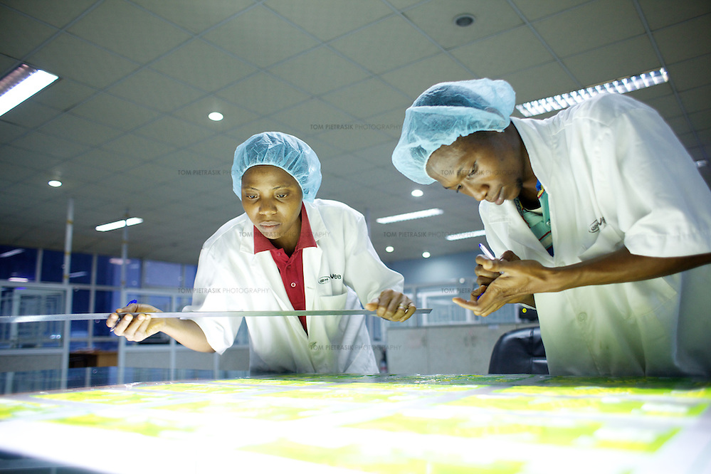 Quality-control workers at a factory producing plastic packaging and labelling for Nigerian and multinational companies. Photo: Tom Pietrasik.Ogun State, Nigeria. 2012 (Tom Pietrasik)