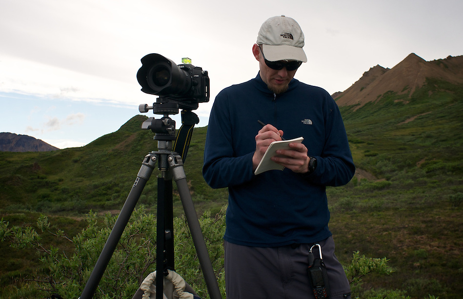 June 26, 2011, Geologist and Photographer Ron Karpilo repeating a photograph taken in 1916 by U.S. Geological Survey geologist Stephen R. Capps near Polycrome Pass, Denali National Park and Preserve, Alaska, United States. (Lacy Karpilo)