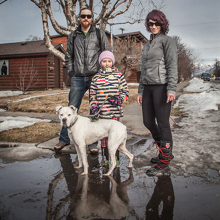 "Zach Lyons and Courtney Gritsch with their daughter, Kamryn (8) and dog ""Poppie"" at the corner of 13th and H Street, Anchorage.  ""Good food is very important to us.""  zlyons@blm.gov (© Clark James Mishler)"