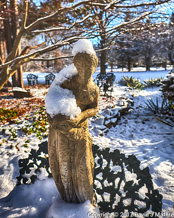 It snowed last night! Statue standing on a bench. Composite of three images taken with Fuji X-T1 camera and 16 mm f/1.4 lens (ISO 200, 16 mm, f/2.8, 1/2000 and 1/4000). (David J Mathre)