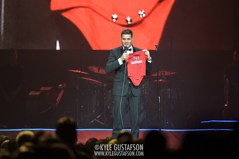 WASHINGTON, DC - September 22nd, 2013 - Performer Michael Bublé holds up a Washington Capitals baby tee, a gift from a fan during his concert at the Verizon Center in Washington, D.C. Bublé and his wife Luisana Lopilato had a son, Noah, in August. (Photo by Kyle Gustafson /  For The Washington Post) (Kyle Gustafson/For The Washington Post)