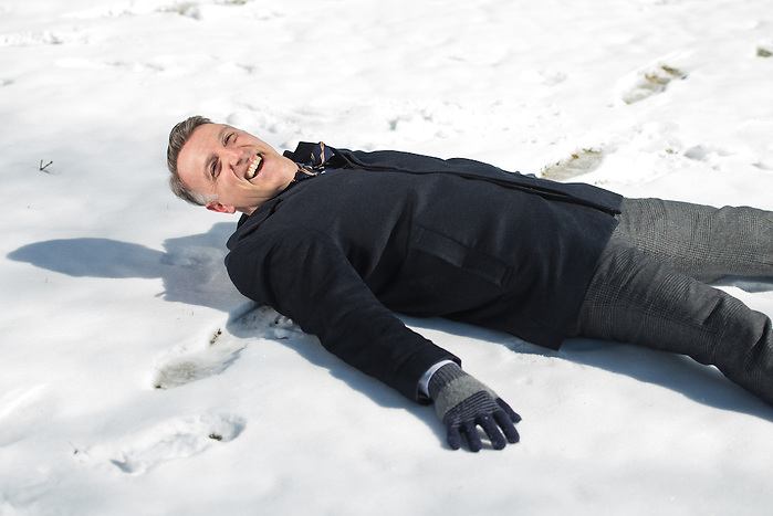 2/12/16 – Medford/Somerville, MA – Dean of Undergraduate Admissions Lee Coffin makes a snow angel on Friday, Feb. 12, 2016. (Evan Sayles / The Tufts Daily) (Evan Sayles / The Tufts Daily)