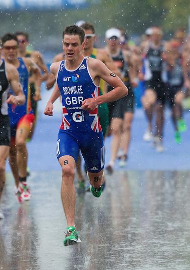 07 AUG 2011 - LONDON, GBR - Jonathan Brownlee (GBR) races through the rain at the start of the second run lap during the men's round of triathlon's ITU World Championship Series .(PHOTO (C) NIGEL FARROW) (NIGEL FARROW/(C) 2011 NIGEL FARROW)