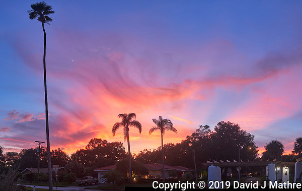 Colorful clouds after sunset. Andalusia Plaza in Granada Terrace. Historic Northeast St. Petersburg, Florida. Composite of 5 images taken with a Leica CL camera and 23 mm f/2 lens (ISO 400, 23 mm, f/2.8, 1/125 sec). Raw images processed with Capture One Pro and AutoPano Giga Pro. (DAVID J MATHRE)