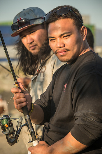 "Brothers Sefa and Ras near the mouth of Ship Creek in Anchorage after an evening of fishing.  ""We got skunked...we're going home and try another day.""  iunisefaz@gmail.com  suniasiaulaiga@yahoo.com (© Clark James Mishler)"