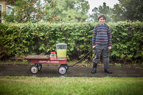 """I'll try again tomorrow.""  -Neighbor Camper Pillifant leaves the Delaney Park Strip with his lemonaid stand during an abrupt storm. (© Clark James Mishler)"