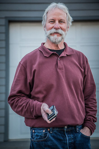 "Neighbor Greg Pittman in front of his garage in Anchorage's South Additiona neighborhood.  ""I'm a transplant…came up from Arkansas 25 years ago…Anchorage has been good to me.""  akmetal@alaska.net (© Clark James Mishler)"