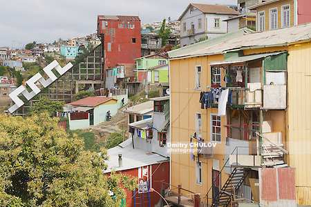 VALPARAISO, CHILE - OCTOBER 19, 2013: View to the poor residential area and closed funicular in Valparaiso, Chile. Only 8 of 26 legendary city funiculars nowadays stay active in Valparaiso. (Dmitry Chulov)