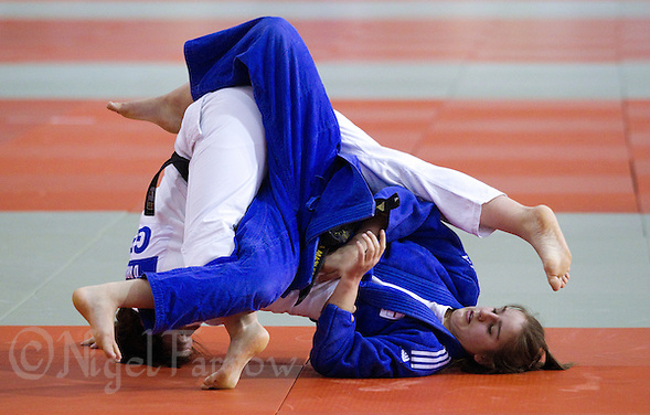 27 MAR 2011 - SHEFFIELD, GBR - Demi Brooks (white) v Natasha Maslen (blue) - English Senior Open Judo Championships .(PHOTO (C) NIGEL FARROW) (NIGEL FARROW/(C) 2011 NIGEL FARROW)