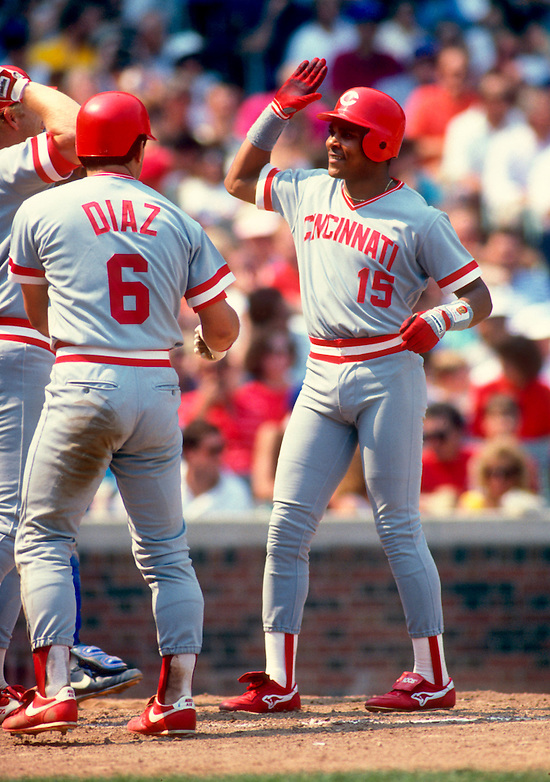 CHICAGO:  Barry Larkin celebrates with Bo Diaz of the Cincinnati Reds after Larkin hit a home run during an MLB game against the Chicago Cubs at Wrigley Field in Chicago, Illinois.  Larkin played for the Reds from 1986-2004.   (Photo by Ron Vesely)   Subject: Barry Larkin. (Ron Vesely)