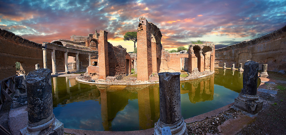 Hadrian's Villa ( Villa Adriana ) 2nd century AD - The Maritime Theatre (  Teatro Marittimo ), so called because of its shape and marine architectural decorations such as Tritons, is at the centre of Hadrian's Villa complex.  At its centre of the Teatro Marittimo is a circular islet surrounded  by a water filled moat which in turn is surrounded by a circular barrel vaulted portico with 40 Ionic columns. The circular building on the islet consisted of rooms that surrounded a central peristyle which was probably a retreat for Hadrian to escape to. Villa Adriana, Tivoli, Italy. A UNESCO World Heritage Site. (Paul E Williams)