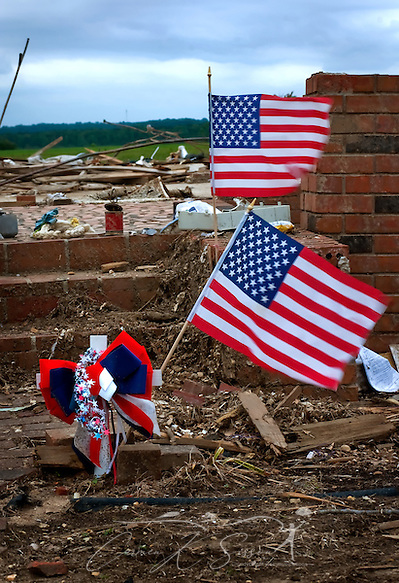 American flags wave amid the rubble of a demolished home May 15, 2011 in Smithville, Mississippi. Jesse Cox, 85, died in the house, and his wife, Nell Cox, 75, was seriously injured when an EF5 tornado swept through the town on April 27, 2011. (Photo by Carmen K. Sisson/Cloudybright) (Carmen K. Sisson/Cloudybright)