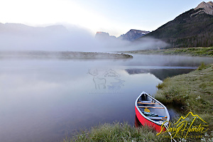 "Red canoe, Green River, Wind River Mountains, Square Top Mountain, foggy morning (Daryl Hunter's ""The Hole Picture"" � Daryl L. Hunter has been photographing the Yellowstone Region since 1987, when he packed up his view camera, Pentex 6X7, and his 35mm�s and headed to Jackson Hole Wyoming. Besides selling photography Daryl also publ)"