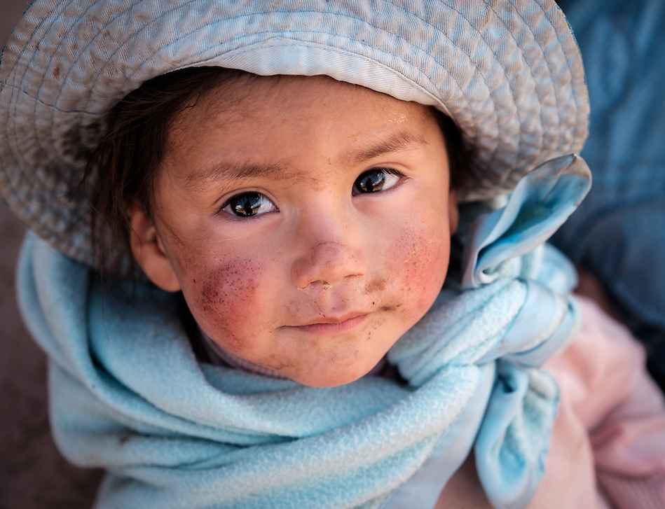 MARAS, PERU - CIRCA OCTOBER 2015: Portrait of local girl in the town of Maras, a small village in the Cusco region known as Sacred Valley (Daniel Korzeniewski)