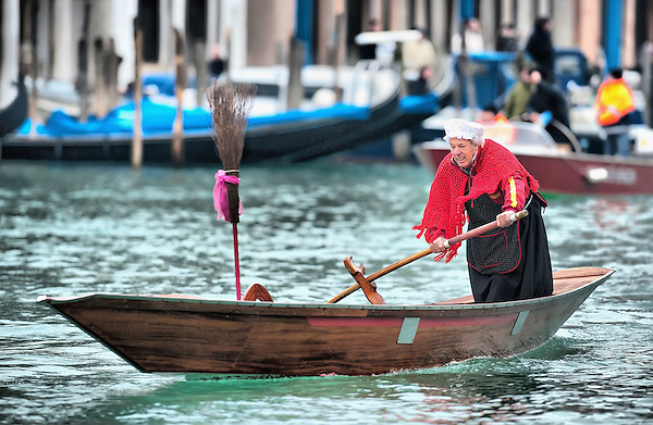 VENICE, ITALY - JANUARY 06: A  participant of the Befana Regata is seen rowing on the Canal Grande on January 6, 2011 in Venice, Italy.  In Italian folklore, Befana is an old woman who delivers gifts to children throughout Italy on Epiphany January 6 iin a similar way to Saint Nicholas or Santa Claus (Marco Secchi/Getty Images)