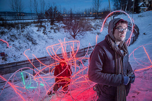 Lighting artist, Scott Pugh, with his installation at Elderberry Park, Anchorage (© Clark James Mishler)