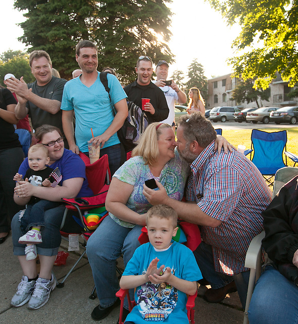 Dedham, MA 06/14/2013 Susan Roche kisses Bill Guilfoyle after accepting his marriage proposal delivered from the back of a truck in the Dedham Flag Day Parade on Friday evening. Wicked Local Photo by Alex Jones (Alex Jones/Wicked Local Photo by Alex Jones)