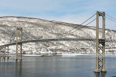 The Tjeldsund suspension road Bridge in winter crossing the Tjeldsundet strait, Troms county, Norway. It is part of a network of bridges that connect islands of Vesteralen and Lofoten to the mainland. (Dmitry Chulov)