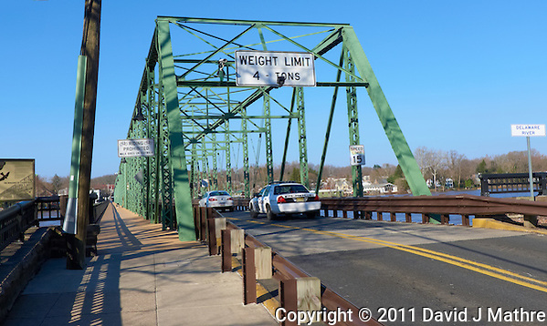 Delaware River -- Flood Stage. Lambertville New Hope Bridge. Image taken with a Leica D-Lux 5 (ISO 100, 7.5 mm, f/4, 1/800 sec). (David J Mathre)