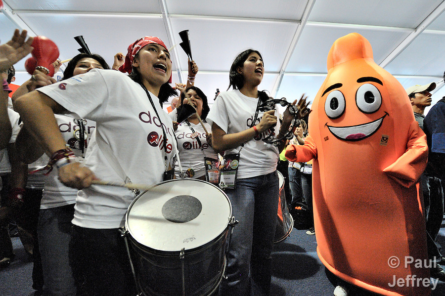 Participants in an August 7, 2010, human rights rally at the XVII International AIDS Conference in Mexico City included a women's band and a giant condom.