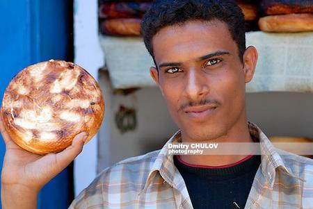 Traditional burned goat cheese seller at the market of Sanaa, Yemen. (Dmitry Chulov)