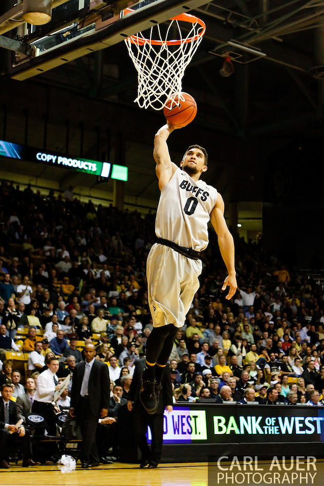 November 13th, 2013:  Colorado Buffaloes junior guard Askia Booker (0) heads to the rim to attempt a dunk in the second half of the NCAA Basketball game between the University of Wyoming Cowboys and the University of Colorado Buffaloes at the Coors Events Center in Boulder, Colorado (Carl Auer/ZUMAPRESS.com)