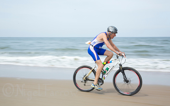 13 JUL 2013 - DEN HAAG, NED - Peter Norman (GBR) (male 75-79) of Great Britain races along the beach during the 2013 ITU Age Group Cross Triathlon World Championships in Kijkduin, Den Haag (The Hague), the Netherlands (PHOTO COPYRIGHT © 2013 NIGEL FARROW, ALL RIGHTS RESERVED) (NIGEL FARROW/COPYRIGHT © 2013 NIGEL FARROW : www.nigelfarrow.com)