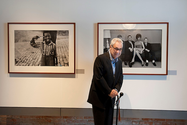 Magnum photographer Elliott Erwitt poses for a picture in front one of his iconic pictures during the press preview of his exhibition 'Personal Best' on March 29, 2012 in Venice, Italy. The exhibition 'Personal Best' on the island of Giudecca will stay open until 15th July 2012 (Marco Secchi)