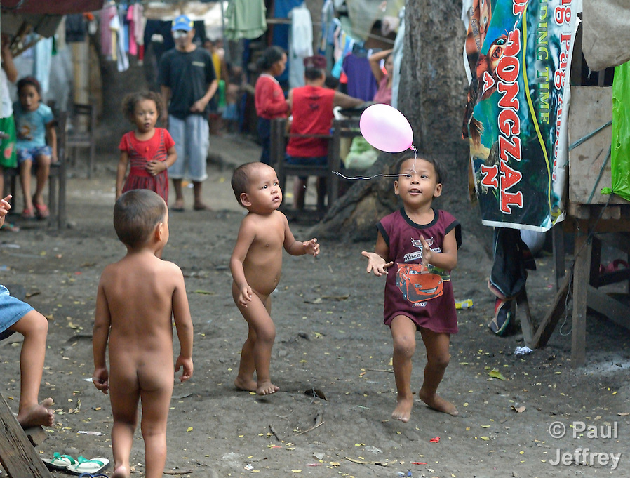 Indigenous children displaced by paramilitary violence play with a balloon in a church compound in Davao, on the southern Philippine island of Mindanao. Hundreds of indigenous are living in the church center, afraid to return home. (Paul Jeffrey)