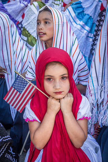"Young members of the Saint Helena's Ballet Folklorico ""El Valle"" contemplate their participation just minutes before start of the Calistoga Fourth of July Parade (Clark James Mishler)"