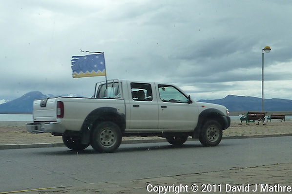 Strikers on Patrol, Driving Through Puerto Natales. Snapshot taken with a Leica V-Lux 20 camera (ISO 125, 5.3 mm, f/5, 1/500 sec). (David J Mathre)